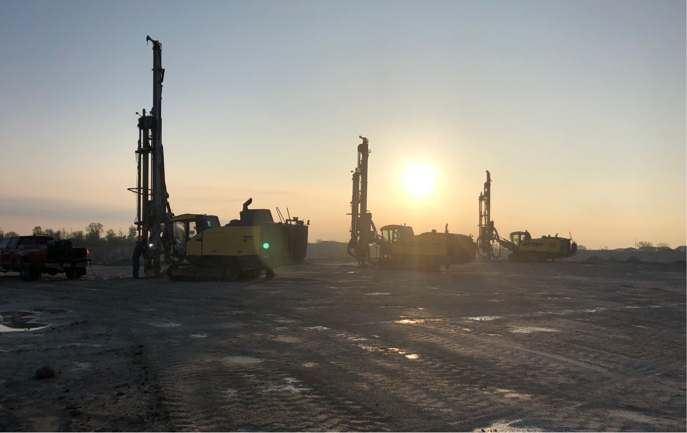 Three drill rigs at work